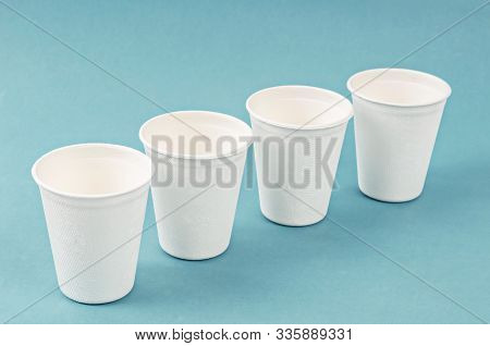 Nature Cup From Bagasse For Drink Water On Blue Background. Eco Friendly Concept.