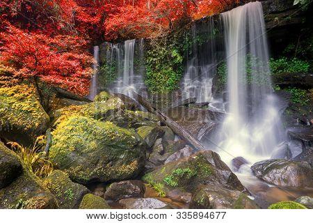 Waterfall Scene At Rom Klao Pharadon Waterfalls In Rainforest  Thailand.