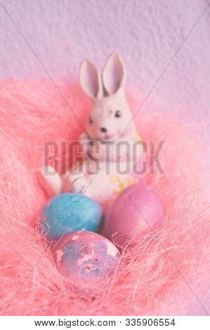 Space Galactic Easter Eggs In A Pink Nest Next To A Rabbit