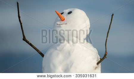 Happy Funny Snowman In The Snow. Cute Snowman In Hat And Scarf On Snowy Field. Snowman Isolated On S