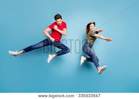Full Size Photo Of Two People Crazy Funky Successful Married Ninja Couple Jump Practice Martial Figh