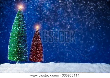 Merry Christmas And Happy New Year Greeting Background. Christmas Lantern On Snow With Fir