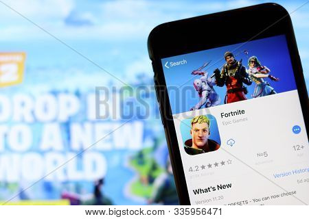Los Angeles, California, Usa - 26 November 2019: Fortnite Icon On Phone Screen With Logo On Blurry B