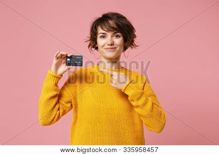 Smiling Young Brunette Woman Girl In Yellow Sweater Posing Isolated On Pastel Pink Wall Background S