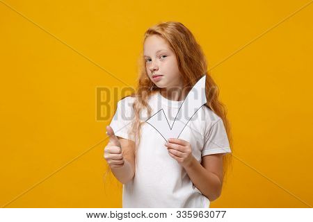 Little Ginger Kid Girl 12-13 Years Old In White T-shirt Isolated On Yellow Wall Background Children