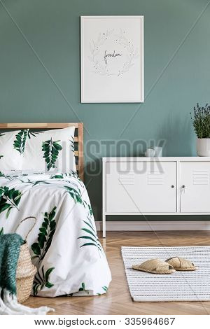 Stylish Interior Design Of Bedroom With Wooden Bed, Mock Up Poster Frame, Rattan White Shelf , Plant