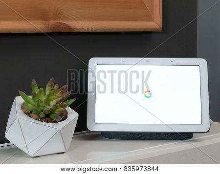 Nov 2019, Uk - Google Nest Hub With Coloured Colored Google Logo On White Background As Device Start