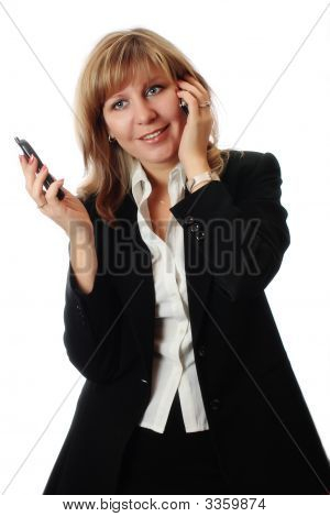 Women Simultaneously Talking On Two Phones