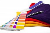 several t shirts and color scale with ballpoint pen poster