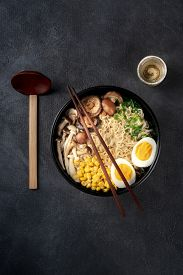 Ramen. Soba Noodles With Eggs, Shiitake Mushrooms, And Vegetables, Overhead Shot On A Dark Backgroun