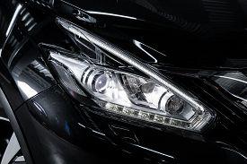Novosibirsk, Russia - October 10, 2019:  Nissan Murano, Macro View Of Modern Black Car Xenon Lamp He
