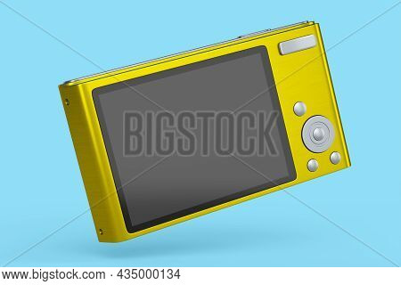 Stylish Yellow Compact Pocket Digital Camera Isolated On Blue Background. 3d Rendered Concept Of Vac