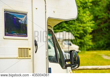 Campers Camping On Campsite In Summer. Traveling By Motor Home. Caravan Vacation.