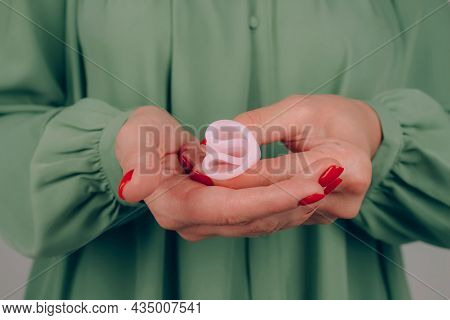Close Up Of Woman Hands With Perfect Manicure, Holding Pink Menstrual Cup - Demonstration Of How To