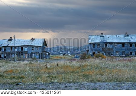 Abandoned Wooden Houses In The Village Of Teriberka On The Kola Peninsula In Northern Russia