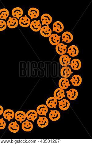 Bright Orange Pumpkins Are Arranged In A Semicircle In Two Rows, Forming A Frame On A Black Backgrou