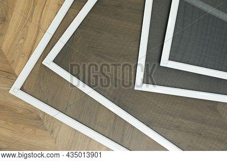 Set Of Window Screens On Wooden Floor, Flat Lay