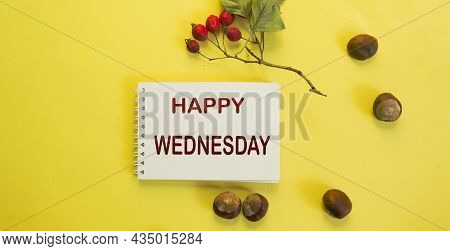Notepad On A Yellow Background With A Hawthorn Branch And Acorns And The Phrase Happy Wednesday