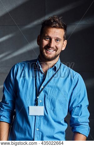 Portrait of happy young handsome man with blue eyes. Casual office worker, businessman.