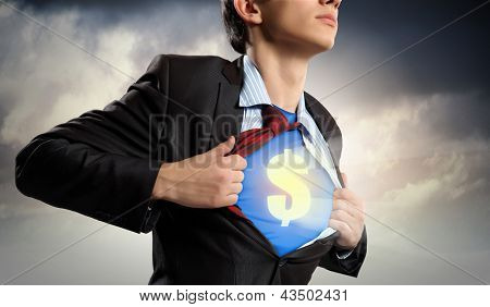Image of young businessman in superhero suit with dollar sign on chest poster