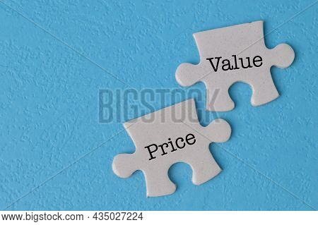 Jigsaw Puzzle With Text Price And Value Isolated On A Blue Background