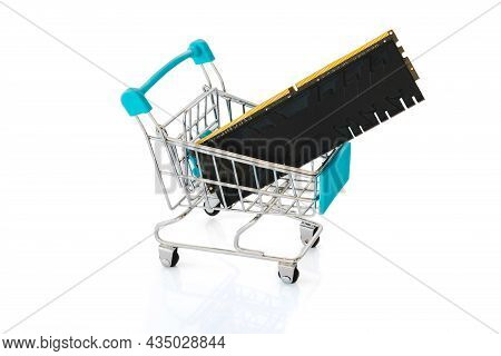 Ram Memory Card With Radiator In A Small Tiny Shopping Cart Trolley Isolated On A White Background.