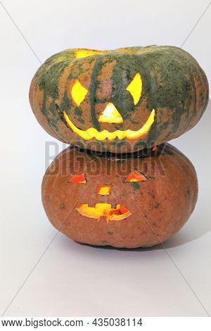 Halloween Big Green Striped Pumpkin On Smaller Orange Pumpkin. Jack O'lantern, Carved Face On Empty
