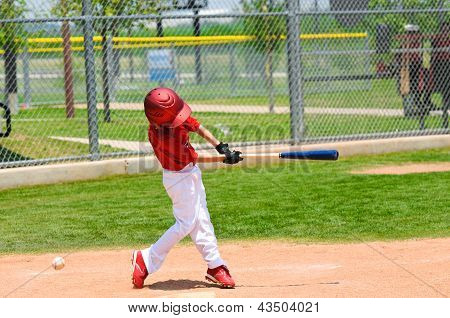 Young Baseball Player Swinging Bat