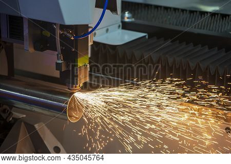 The Fiber Laser Cutting Machine Cutting The Stainless Steel Tube Control By Cnc Program. The Sheet M