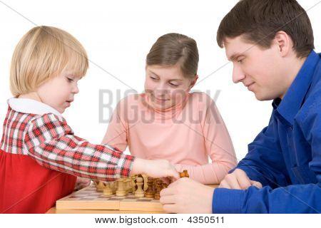 Man And Children Play Chess