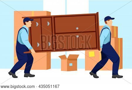 Movers Carry A Heavy Wardrobe. Boxes With Things Are Standing Near The Wall. Relocation. Transport C