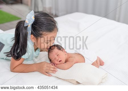 Sister Shows Sign To Quiet With Her Little Brother. Toddler Kid Meeting New Sibling. Cute Girl And N