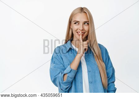 Mysterious Blond Girl Hushing And Smiling, Looking At Upper Left Corner Product And Shushing, Making
