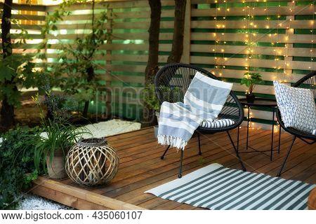 Exterior Veranda Of House With Black Acapulco Armchair And Plants Pots. Cozy Space In Patio Or Balco