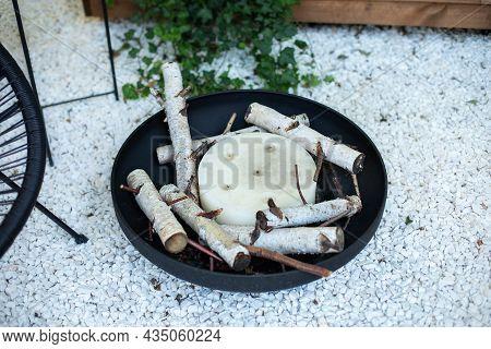Metal Black Fireplace Bowl In Garden On Back Yard Lawn. Patio Fire Steel Pit Round Fireplace Applian