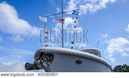 NORWALK, CT, USA - SEPTEMBER 23, 2021:   Low angle view from Everglades boat and flags on wind at Progressive Norwalk Boat Show September 23-26 2021