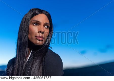 Portrait Of A Transgender Female Looking Distracted Aside