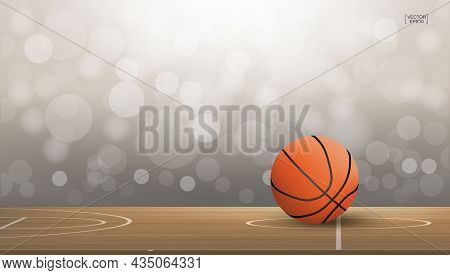 Basketball Ball On Basketball Court Area With Light Blurred Bokeh Background. Abstract Background Fo