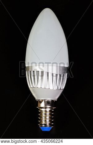 A Diode Lamp With A Small Base, Economical In Operation, A Large Resource. Isolated On A Black Backg