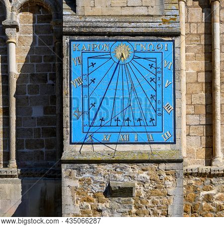 The Sun Dial At Ely Cathedral In Sunshine. The Inscription Reads