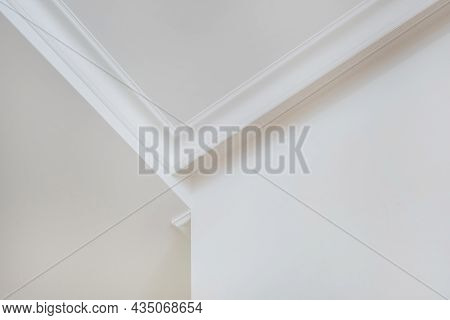 Detail Of Corner Ceiling Cornice With Intricate Crown Moulding.
