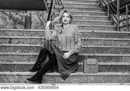Nice Day. Girl In Corrugated Skirt And Sweater. Pleated Trend. Autumn Woman Curly Hair Outdoor. Casu