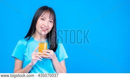 Beautiful Beauty Asian Woman Cute Girl With Bangs Hair Style In Blue Shirt Feel Happy Drinking Orang