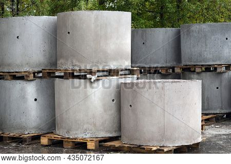Reinforced Concrete Rings Of A Well Or Sewer In Outdoors. Industrial Production Structures At Store'