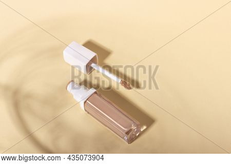 Concealer Cream On A Background With Shadows. Face Corrector On Beige Background With Copy Space. Bl