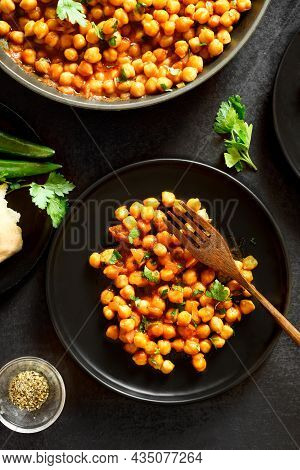 Indian Style Crispy Roasted Chickpeas Over Black Stone Background. Top View, Flat Lay