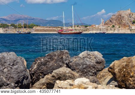 Kerkyra. Greece. View Of The Coastline And Ships On A Sunny Day.