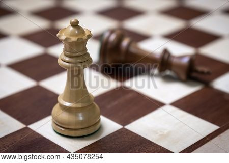 Wooden Chess Pieces On A Chessboard. Board Game