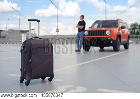 Suitcase Close-up Outdoors On The Background Of The Car.