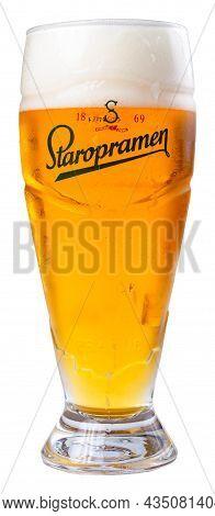 Uzhgorod, Ukraine - Sep 02, 2015: Glass Of Beer With Staropramen Label. Yellow Alcohol Drink With Fo